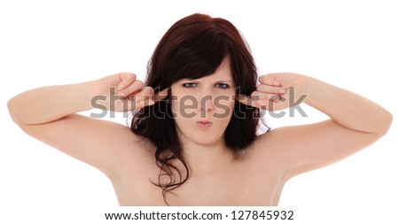 Attractive young woman keeps her ears shut. All on white background. - stock photo
