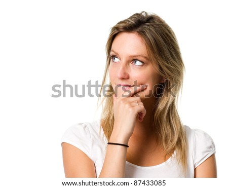 Attractive young woman making a choice and looking into copyspace
