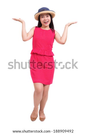 Attractive young woman of Asian standing, full length portrait isolated on white background. - stock photo