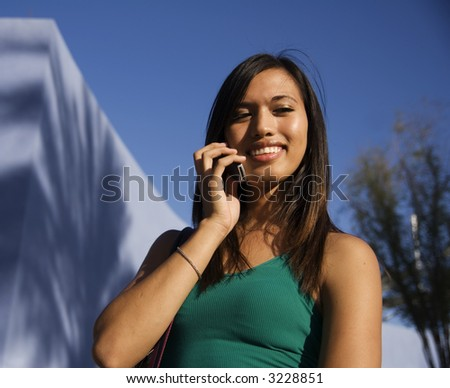 Attractive Young Woman on cell phone - stock photo