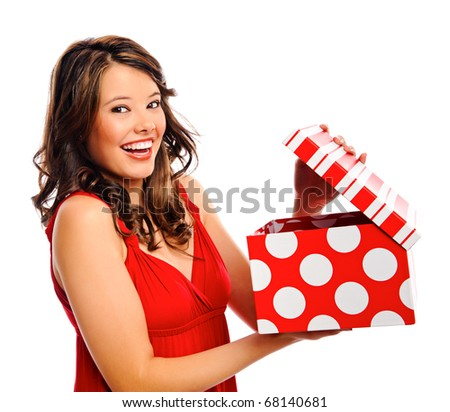 Attractive young woman opens the present she received - stock photo