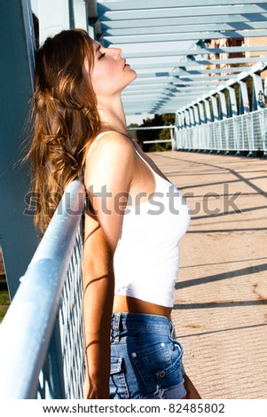 attractive young woman outdoor summer portrait onthe bridge