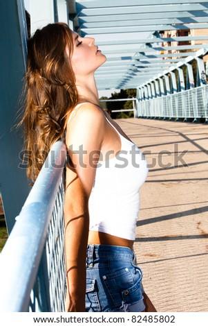 attractive young woman outdoor summer portrait onthe bridge - stock photo