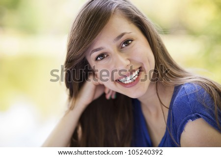 Attractive young woman outdoors - stock photo
