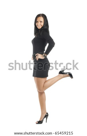 Attractive young woman posing in short pretty black dress - stock photo