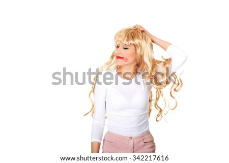 Attractive young woman pulls his blond wig out. - stock photo