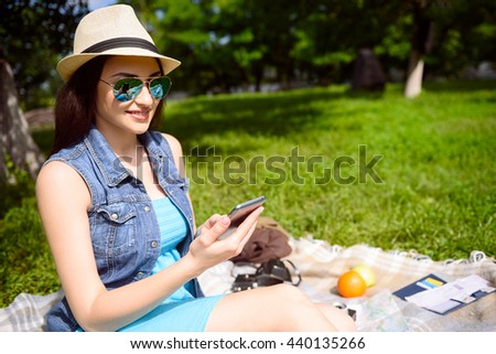 Attractive young woman resting in the nature