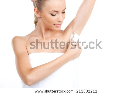 Attractive young woman shaving her armpits. girl shaving armpit on white background - stock photo
