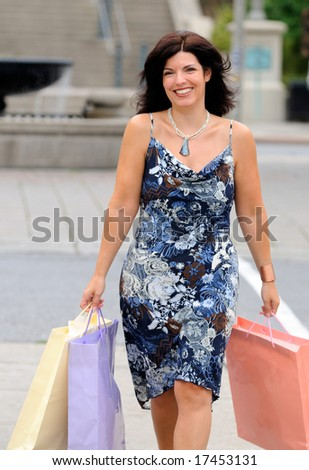 Attractive Young Woman Shopping For Fashion Clothes In The City - stock photo