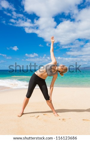 Attractive Young Woman Stretching at the Beach - stock photo