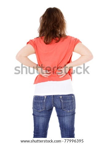 Attractive young woman suffering from back pain. All on white background.