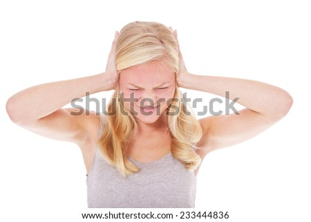 Attractive young woman suffers from noise. All on white background. - stock photo