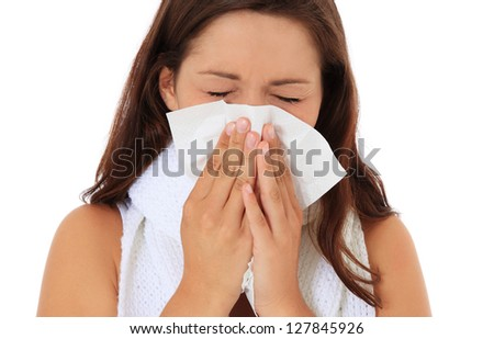 Attractive young woman using tissue. All on white background. - stock photo