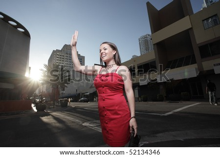 Attractive young woman waving