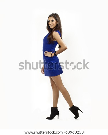 Attractive young woman wearing blue dress - stock photo