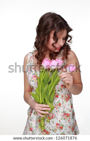 Attractive young woman wearing clothes with floral ornament on Holiday theme/Portrait  of beautiful smiley girl on Beauty and Fashion theme - stock photo