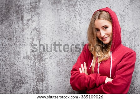 Attractive young woman wearing red hoodie - stock photo