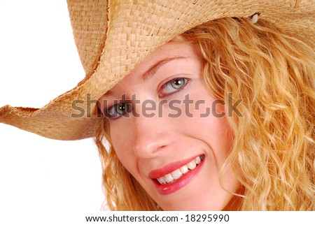 Attractive young woman with a big smile wearing straw cowboy hat.