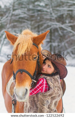 Attractive Young Woman with a Horse the Snow