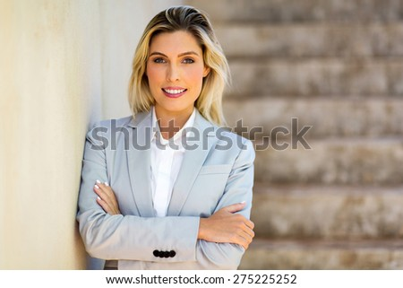 attractive young woman with arms crossed  - stock photo