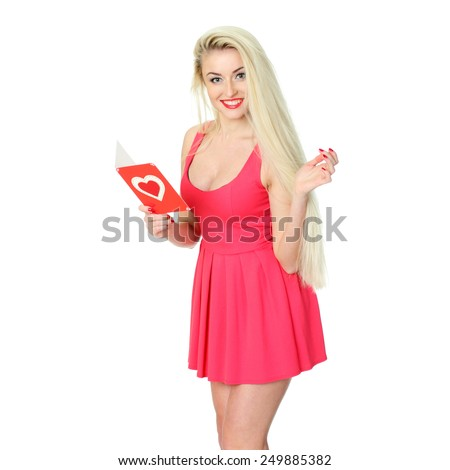 Attractive young woman with card on Valentine Day. Young romantic girl with Valentines card