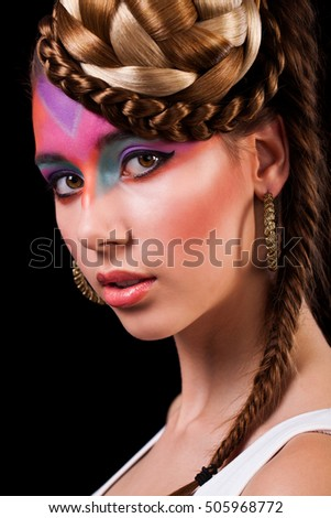 attractive young woman with colorful make-up