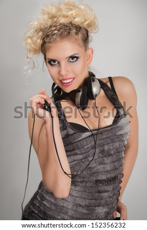 Attractive young woman with headphones listening to the music