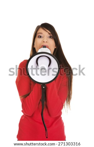 Attractive young woman with megaphone. - stock photo
