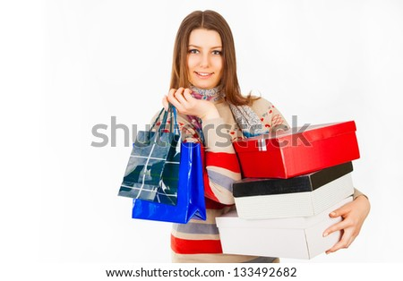 Attractive young woman with packages, boxes and good, happy emotion - isolated on a white background. Good winter, spring, autumn sales in shop