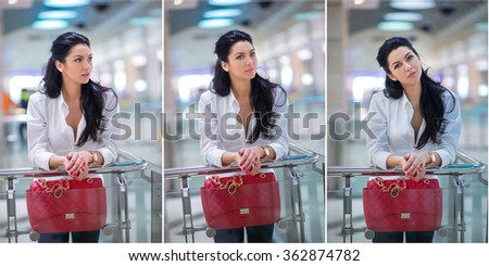 Attractive young woman with red bag in shopping center. Beautiful fashionable young lady with long hair in white male shirt in mall. Casual long hair brunette posing smiling and teasing, indoors shot - stock photo