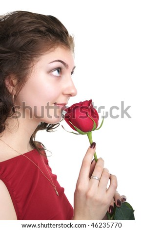 Attractive young woman with red rose isolated on the white background - stock photo