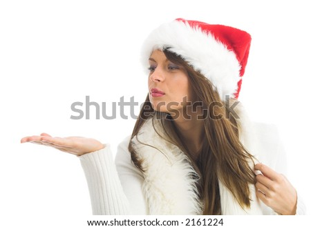 Attractive young woman with Santa Claus hat looking a hand - stock photo