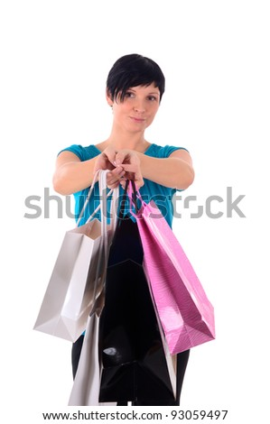 attractive young woman with shopping bags - stock photo