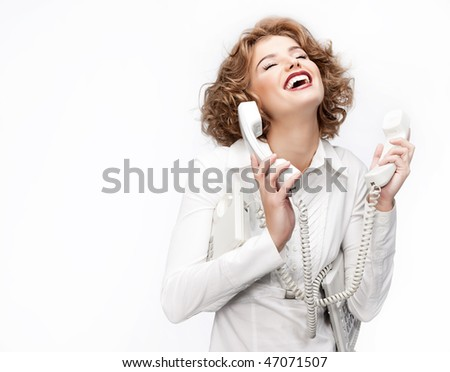 attractive young woman with telephone on white background - stock photo