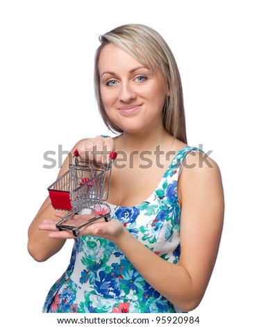 Attractive young woman with toysshopping cart on white background - stock photo