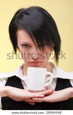 Attractive young woman with white cup close up