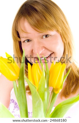 attractive young woman with yellow tulips - stock photo