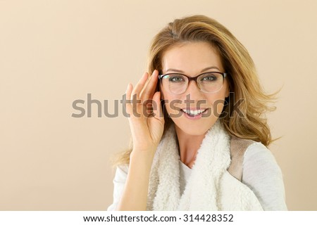 Attrative trendy mature woman with eyeglasses, isolated - stock photo