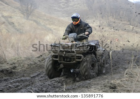 atv racing on dirt track at spring - stock photo