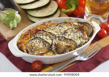 aubergine  bake with courgette, pumpkin and tomatoes - stock photo