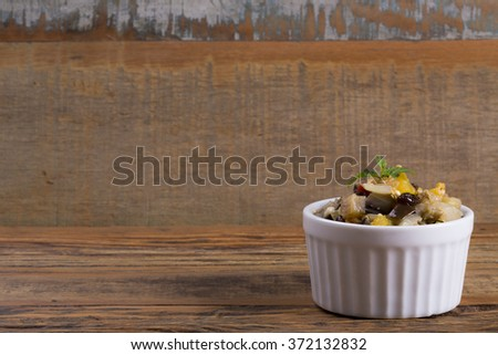 Aubergine with raisins grape and red peppers, yelow and green/ Aubergine with raisins grape/ Aubergine with raisins grape and peppers - stock photo