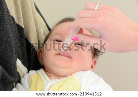 AUCKLAND - AUG 14 2014:Nurse giving newborn baby Rotavirus vaccine immunisation.It protects children from rotaviruses, which are the leading cause of severe diarrhea among infants and young children - stock photo