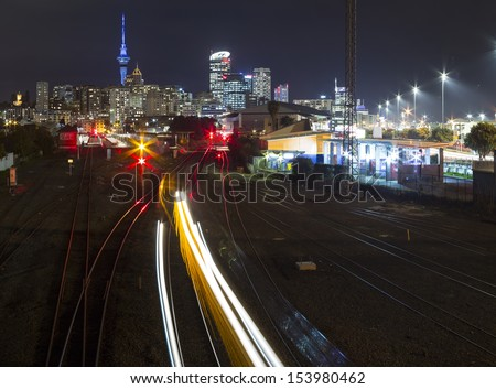 Auckland City/ Auckland City at night from above it's rail system - stock photo