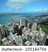 Auckland city & harbour vertical aerial panorama looking east to Rangitoto Island, New Zealand. - stock photo