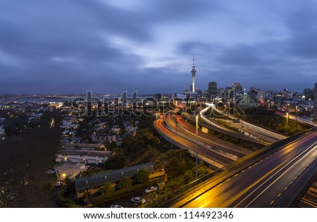Auckland City Lights/ Auckland's CBD after dusk during a storm, hence the wet roads and dramatic sky - stock photo