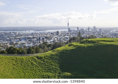 Auckland City New Zealand, showing the harbour bridge and Sky Tower - stock photo