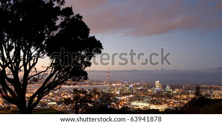 Auckland City skyline at sunset, hilltop view, new zealand - stock photo
