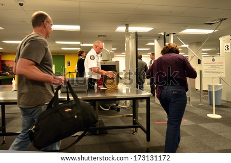 AUCKLAND - DEC 31:Airport security station on Dec 31 2013.Since the 1970s, Air Terrorism, hijackings and bombings became the method of choice for subversive, militant organizations around the world. - stock photo