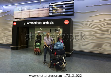 AUCKLAND - DEC 31:Visitors arrive to Auckland Airport on Dec 31 2013.It's the largest and busiest airport in NZ with 14,829,393 passengers in the year ended November 2013. - stock photo