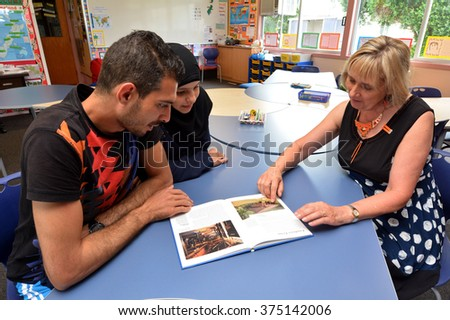 AUCKLAND - FEB 21 2016:Auckland University of Technology teacher teaches Syrian refugee English at Mangere Refugee Resettlement Centre.New Zealand annual intake is 750 refugee fleeing war in Syria. - stock photo